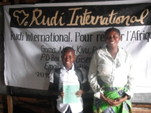 Picture of children after receiving back to school kit from Rudi Education