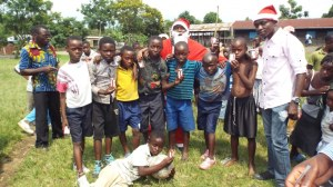 The winning team posing with Arsene Tungali and Santa