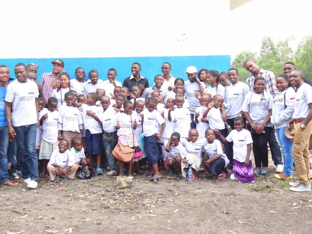 A picture of Rudi International Volunteers and beneficiary children rejoicing together as they remember the birth of Christ and the meaning of giving of oneself to others.